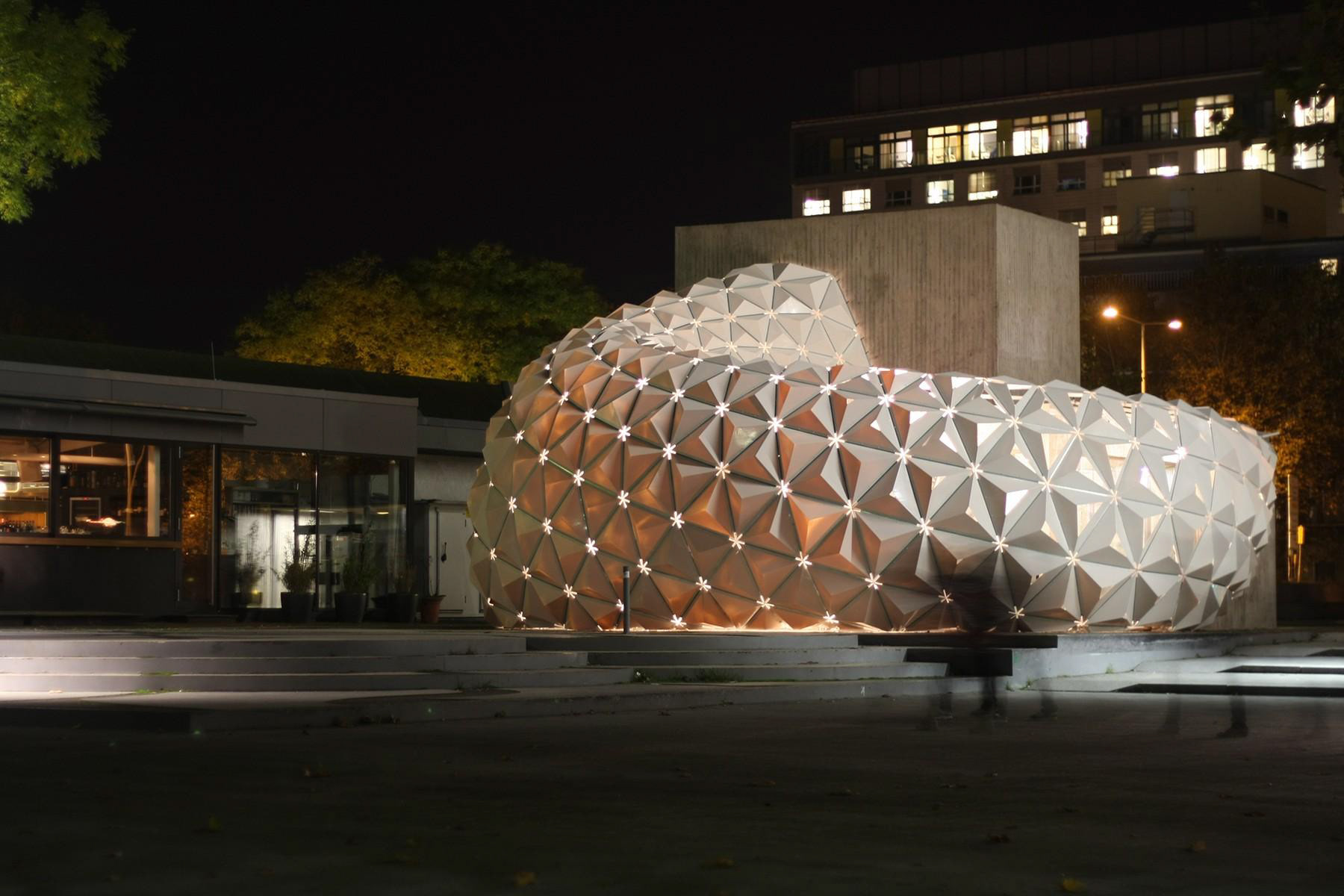 Trizone architecture parametric design durable recyclable facade the blueprint is based on a triangular net made upof mesh elements of varying sizes malvernweather Gallery