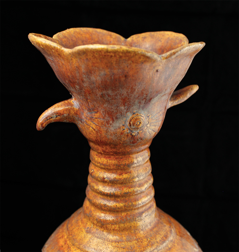 The wil farrow collection a phoenix head ewer it is a non functional burial vessel simulating the shape of a ewer stoneware with yellow glaze over a white slip 17 in 4318 cm reviewsmspy